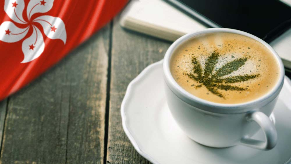 Cup of coffee with cannabis leaf on top and a Hong Kong flag next to it