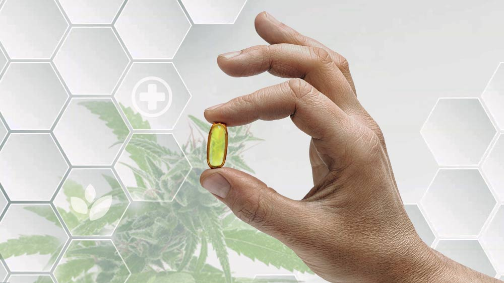 A yellow pill and cannabis in the background