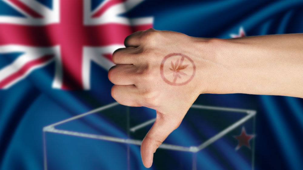 New Zealand flag and a hand with a weed tattoo showing a thumbs down sign